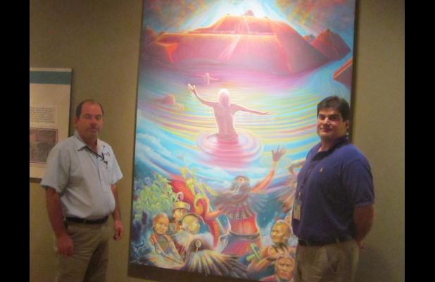"Earl Barbry Jr. (right) and Brent Barbry Sr. stand in front of a painting depicting the ""creation story"" of the Tunica people, which is displayed in the Tunica-Biloxi Museum in Marksville. {Photo by Raymond L. Daye}"