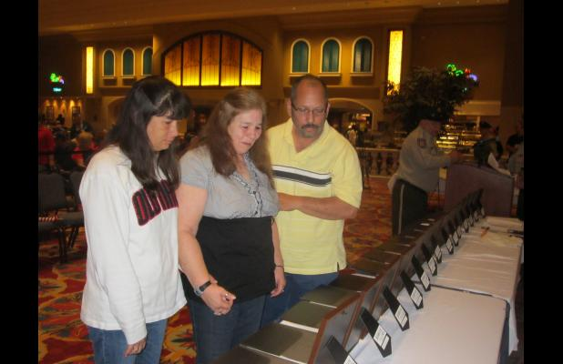 Gail Sierra (center), with her husband Jose Sierra and daughter Laurie McNeal view a memorial plaque in honor of her brother, Sgt. Michael Nugent of Marksville, who died on Christmas Eve 1970 in Vietnam. 14 Avoyelles Parish men who died in that war were honored at Memorial Day ceremonies at Paragon Casino Resort Monday.